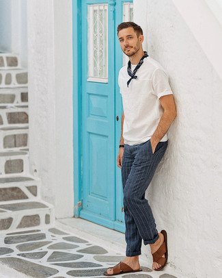 How to wear: navy bandana, brown leather sandals, navy vertical striped dress pants, white crew-neck t-shirt