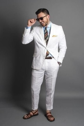 How to Wear a White Suit: This polished combination of a white suit and a light blue dress shirt is a must-try outfit for today's man. Brown leather sandals are the simplest way to inject a dose of stylish effortlessness into this look.