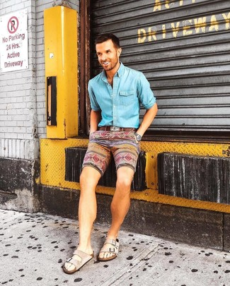How to wear: brown leather belt, beige suede sandals, multi colored print shorts, light blue denim shirt