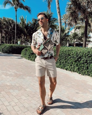 How to wear: brown print canvas fanny pack, grey leather sandals, beige shorts, white floral short sleeve shirt