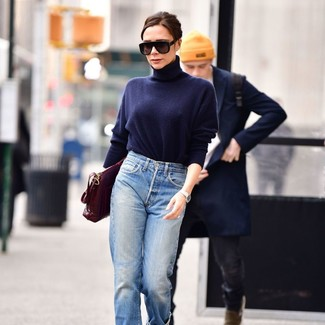 How to wear: black sunglasses, burgundy leather satchel bag, light blue boyfriend jeans, navy turtleneck