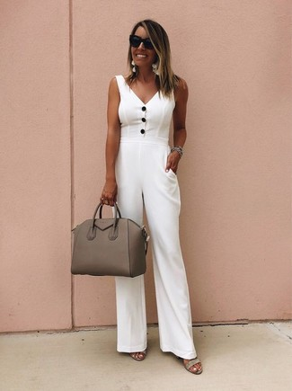 How to wear: black sunglasses, brown leather satchel bag, grey suede heeled sandals, white jumpsuit