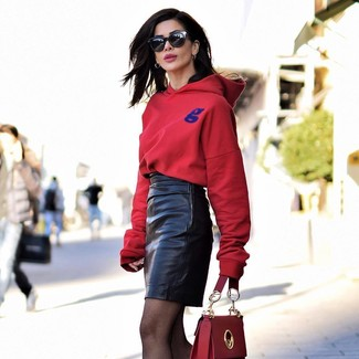 How to wear: black sunglasses, red leather satchel bag, black leather mini skirt, red hoodie