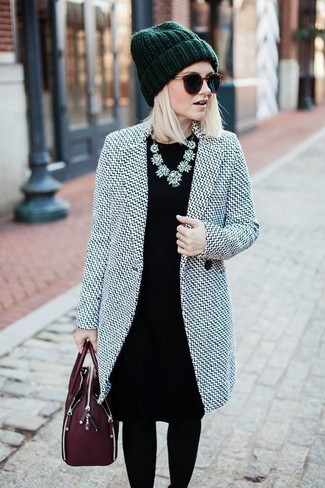 How to wear: dark green beanie, burgundy leather satchel bag, black sheath dress, grey coat