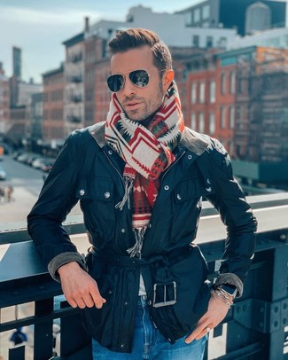 How to wear: black sunglasses, multi colored print scarf, blue jeans, navy barn jacket