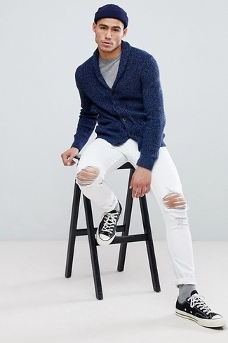 How to wear: navy shawl cardigan, grey crew-neck t-shirt, white ripped jeans, black and white canvas low top sneakers
