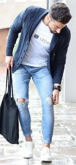 How to wear: navy shawl cardigan, white print crew-neck t-shirt, light blue ripped skinny jeans, white leather low top sneakers