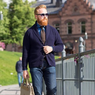 How to wear: navy shawl cardigan, blue denim shirt, navy jeans, beige leather tote bag