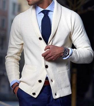 How to wear: beige shawl cardigan, light blue dress shirt, navy dress pants, navy tie
