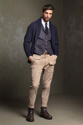 How to wear: navy shawl cardigan, navy waistcoat, white dress shirt, beige cargo pants