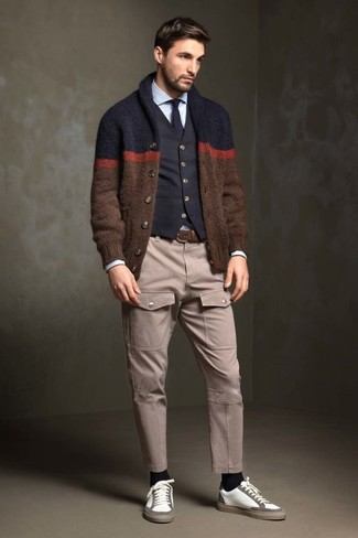 How to wear: brown shawl cardigan, black cotton waistcoat, light blue dress shirt, beige cargo pants