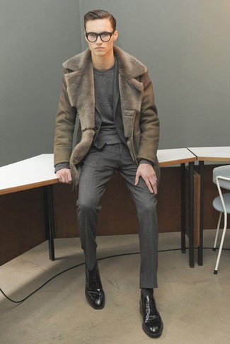 How to wear: olive shearling coat, charcoal wool suit, charcoal crew-neck sweater, black leather derby shoes