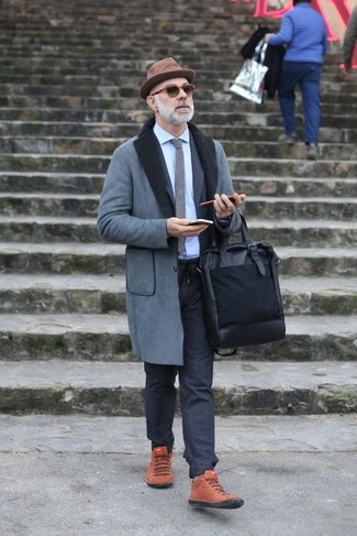 How to wear: grey shearling coat, charcoal wool suit, light blue dress shirt, tobacco suede high top sneakers