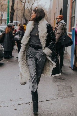 How to wear: black and white shearling coat, charcoal turtleneck, grey tapered pants, black suede mid-calf boots