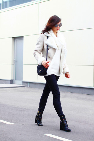 How to wear: white shearling jacket, white cowl-neck sweater, black skinny jeans, black leather lace-up ankle boots