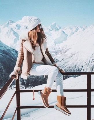 How to wear: beige shearling jacket, beige crew-neck sweater, white skinny jeans, tan uggs