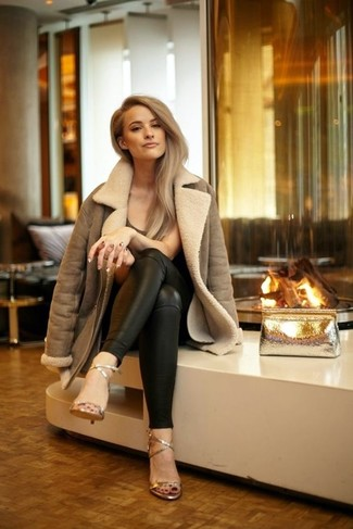 How to wear: brown shearling jacket, dark brown crew-neck t-shirt, black leather skinny pants, gold leather heeled sandals