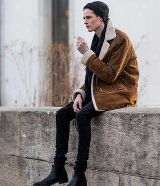 How to wear: tobacco shearling jacket, black skinny jeans, black leather chelsea boots, black beanie