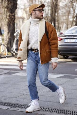 How to wear: tobacco shearling jacket, white knit wool turtleneck, blue jeans, white leather low top sneakers