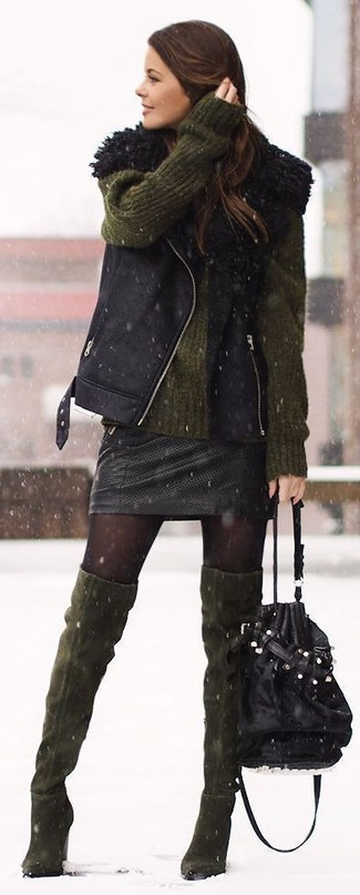 How to wear: black shearling vest, olive oversized sweater, black leather mini skirt, olive suede over the knee boots