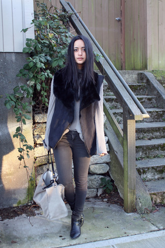 How to wear: black shearling vest, grey knit turtleneck, charcoal skinny jeans, black leather ankle boots