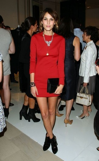 Alexa Chung wearing Red Sheath Dress, Black Leather Ankle Boots, Black Leather Clutch, Silver Necklace