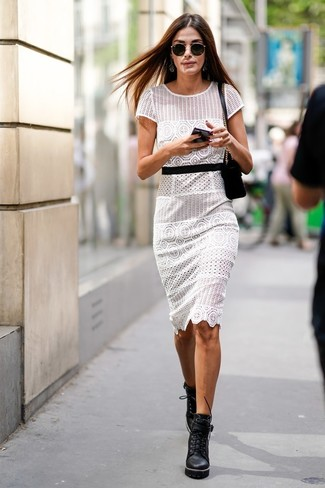 How to wear: white crochet sheath dress, black chunky leather lace-up ankle boots, black suede crossbody bag, black sunglasses