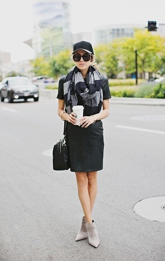 Pair a black leather shift dress with a black cap to achieve new levels in outfit coordination. This ensemble is complemented perfectly with grey suede ankle boots. Seeing as temperatures are dropping, this look is a great idea for the time in between seasons.