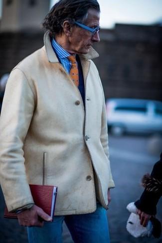 How to wear: beige shirt jacket, navy blazer, white and blue vertical striped dress shirt, blue jeans