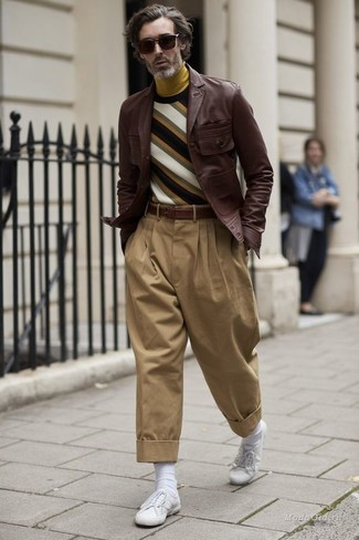 How to wear: dark brown leather shirt jacket, multi colored horizontal striped crew-neck sweater, mustard turtleneck, khaki chinos