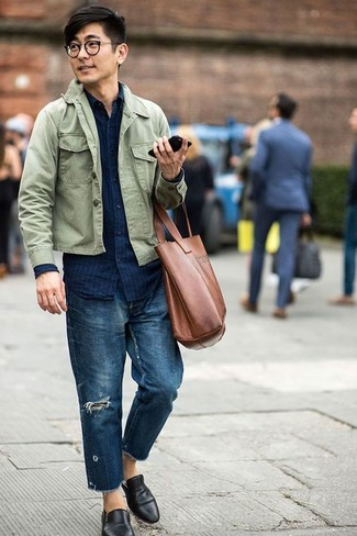 How to wear: olive shirt jacket, navy vertical striped denim shirt, navy ripped jeans, black leather loafers