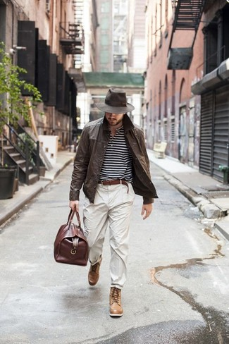 How to wear: dark brown leather shirt jacket, black and white horizontal striped henley shirt, beige chinos, tan leather casual boots