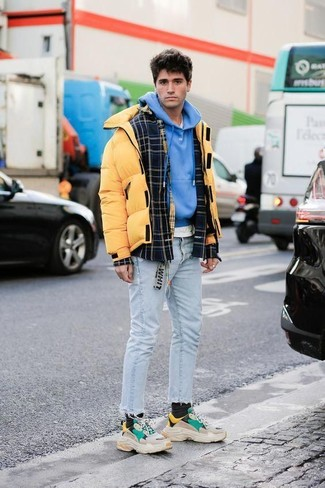 How to wear: black plaid wool shirt jacket, yellow puffer jacket, blue hoodie, white crew-neck t-shirt