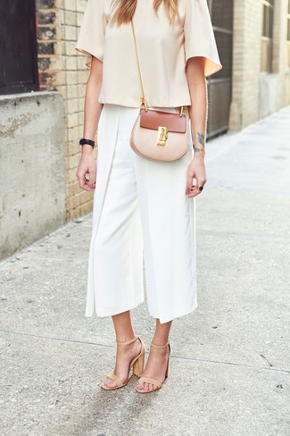 How to wear: beige short sleeve blouse, white culottes, tan leather heeled sandals, beige leather crossbody bag