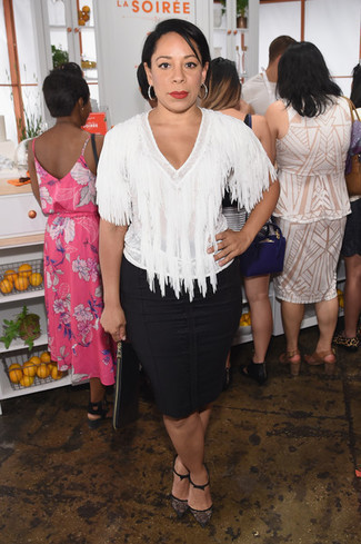 Step up your off-duty look in a white fringe short sleeve blouse and a black pencil skirt. Rochas Lace Pumps With Front Bow are an easy option here. This look is also great if you're searching for warm weather wear to get through a slow day in the office.