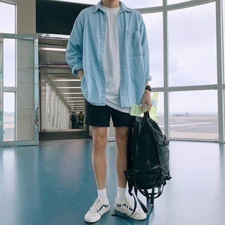 Men's Looks & Outfits: What To Wear In 2020: No matter where the day takes you, you can rely on this relaxed casual combination of a light blue denim shirt and black shorts. Let your sartorial skills truly shine by complementing your outfit with white and navy low top sneakers.