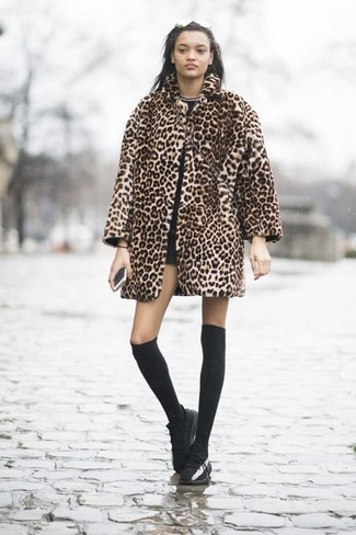 How to wear: black leather low top sneakers, black shorts, black crew-neck t-shirt, tan leopard fur coat