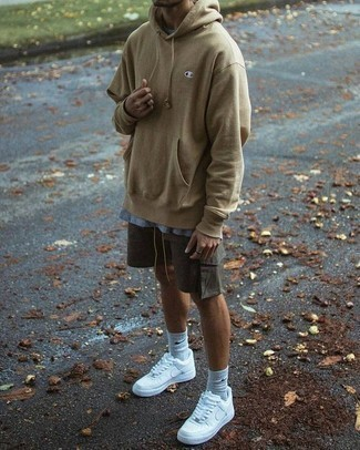 Men's Looks & Outfits: What To Wear In a Relaxed Way: If the setting allows casual dressing, pair a tan hoodie with charcoal shorts. For a more relaxed take, why not introduce white athletic shoes to the mix?