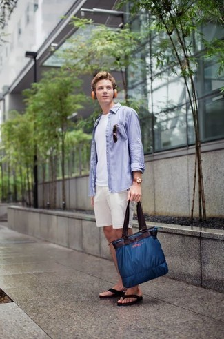 How to Wear a Navy Canvas Tote Bag For Men: Pair a light blue long sleeve shirt with a navy canvas tote bag for a comfy-casual outfit. Add a pair of black flip flops to your outfit to keep the ensemble fresh.