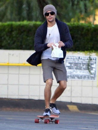 How to wear: blue low top sneakers, grey shorts, white crew-neck t-shirt, navy shawl cardigan