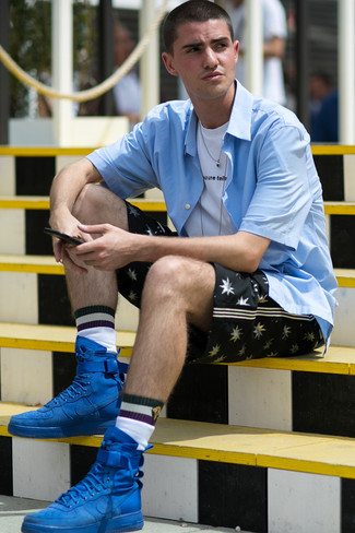 How to wear: blue suede high top sneakers, black print shorts, white and black print crew-neck t-shirt, light blue short sleeve shirt