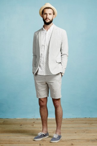 How to wear: navy canvas low top sneakers, grey shorts, white polka dot dress shirt, grey blazer