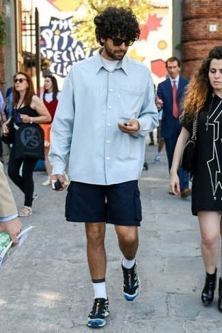 Men's Looks & Outfits: What To Wear In 2020: Fashionable and comfortable, this casual combo of a white turtleneck and navy shorts provides variety. For a more casual feel, add black athletic shoes to the equation.