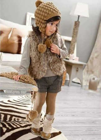How to wear: beige boots, grey shorts, grey long sleeve t-shirt, brown fur vest