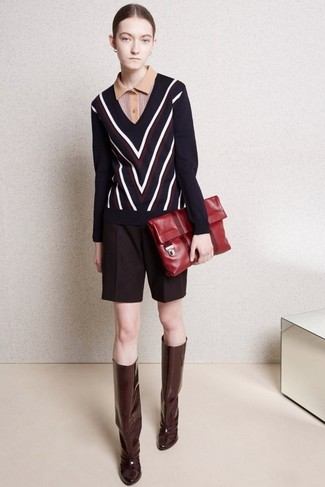 How to wear: burgundy leather knee high boots, burgundy wool shorts, tan polo, navy chevron v-neck sweater