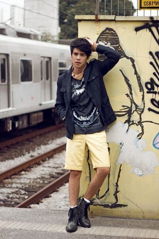 How to wear: black leather brogue boots, yellow shorts, black and white print sweatshirt, black field jacket