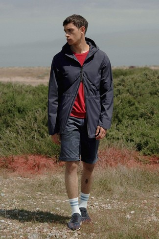 How to wear: charcoal low top sneakers, black shorts, red sweatshirt, black fishtail parka
