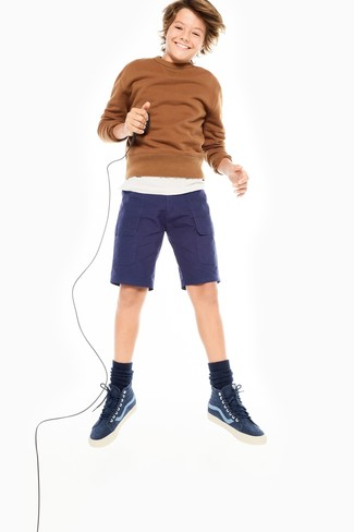 Boys' Looks & Outfits: What To Wear In 2020: Your little man will look extra adorable in a brown sweater and navy shorts. As far as footwear is concerned, suggest that your kid go for a pair of navy sneakers.