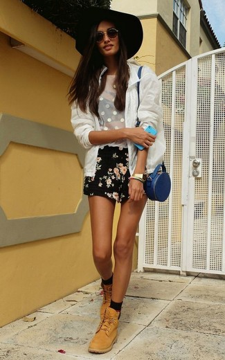 How to wear: tan leather lace-up flat boots, black floral shorts, white mesh tank, white mesh bomber jacket