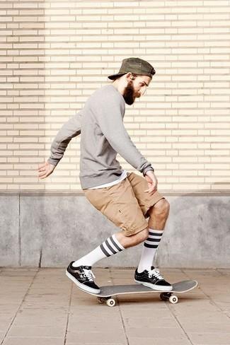 How to wear: black plimsolls, tan shorts, white tank, grey crew-neck sweater